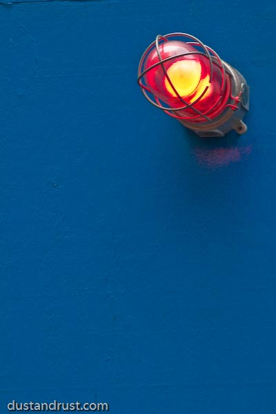 Red Light on Blue Wall